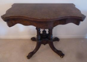 A Victorian shaped rectangular mahogany and walnut card table, on four scroll supports, 93 x 49 x