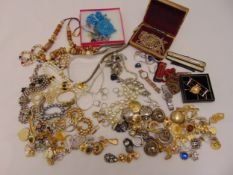 A quantity of costume jewellery to include necklaces, earrings and bangles