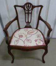 A Victorian mahogany occasional armchair with pierced back on cabriole legs