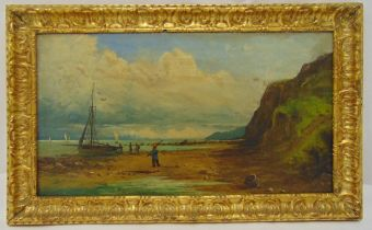 A framed Victorian oil on canvas of fishermen on the beach by their boats, indistinctly signed