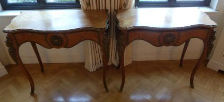 A pair of French shaped rectangular Kingswood tables with marquetry tops and applied gilded metal