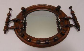 A Victorian mahogany wall mounted spindle mirror of circular form, 31 x 37cm