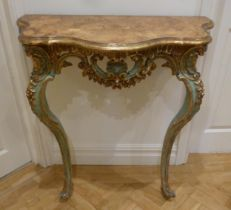 A consol table shaped rectangular, carved with shells and swags on two cabriole legs, 84 x 77 x