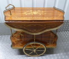 A Sorrento shaped rectangular wooden hostess trolley with two wheels and scroll handles