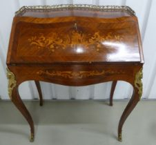 A French style Kingswood rectangular inlaid bureau with tooled leather desk, drawers and gilded