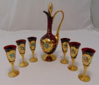 Venetian glass decanter and six matching glasses decorated with floral sprays