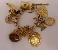 Yellow gold charm bracelet, tested 9ct with ten individual gold charms and four gold plated
