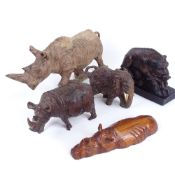 A group of carved hardwood animals, including rhino and boar, largest length 32cm (5)