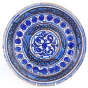 A 19th century European pottery charger, blue and white glaze decoration, diameter 32cm