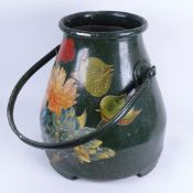 A large Toleware aluminium bucket, printed floral decoration with swing handle, height 36cm