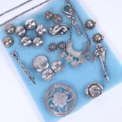 A collection of Scandinavian Folk Art and Art Nouveau silver jewellery, various brooches and