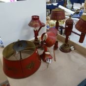 A group of 20th century Toleware red painted and gilded brass light fittings, including ceiling