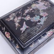 An early 20th century Japanese black lacquer and abalone rectangular jewellery box, bird and