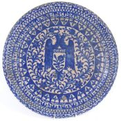 A large Hispano-Moresque blue and white pottery charger, with double-headed eagle decoration,