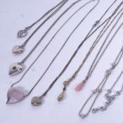 9 various silver pendant necklaces, heart-shaped