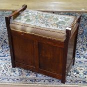 An Edwardian mahogany piano stool, with needlework upholstered seat, W55cm