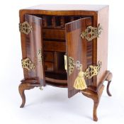 A miniature satinwood rosewood and walnut apprentice piece serpentine-front cabinet on stand,