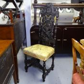 A Victorian acanthus leaf carved and pierced hall chair, in Carolean style with silk upholstered