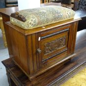 A late Victorian mahogany music stool with adjustable seat, carved panelled door and shelved