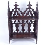 A 19th century carved and pierced mahogany Gothic bookshelf, width 33cm, height 48cm