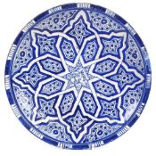 A large Persian Middle Eastern blue and white pottery charger, with Islamic decoration and Arabic