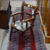 An Antique elm-seat child's armchair