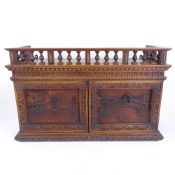 A Grand Tour style carved mahogany wall-hanging cabinet, with Venetian scene carved panel doors,