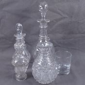 Two Victorian decanters, a water / whisky carafe and pepper, tallest 28cm. (4)