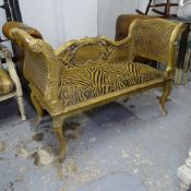 A giltwood and cane-panelled window seat, on cabriole legs, W123cm, H80cm