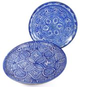 2 Moroccan blue and white pottery chargers, largest diameter 38.5cm, 1 A/F, (2)