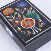 A Pietra Dura and black slate dressing table box and cover, floral decorated lid with inset