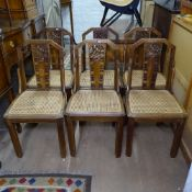 A set of 6 1930s dining chairs, with carved backs and cane seats