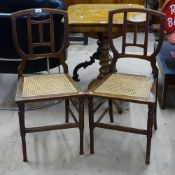 A pair of Shoolbred Aesthetic Movement side chairs, with cane seats and stamped marks