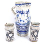 A large Spanish blue and white glazed pottery water flagon, and a pair of Dutch pottery beakers,