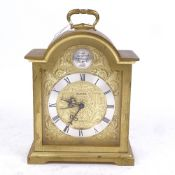 A Swiza cast-brass dome-top 8-day mantel clock, gilt face with silvered chapter ring and 15 jewel