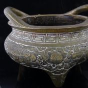 A Chinese bronze 2-handled incense burner, with dragon decorated frieze raised on 3 feet,