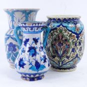 3 Iznik / Persian earthenware vases, tallest 18cm. All vases have chips and glaze loss at rim and