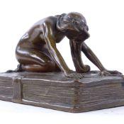 FRANZ BERGMAN - Austrian patinated bronze sculpture, nude figure kneeling on a book, unsigned,