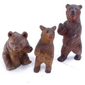 3 19th century Black Forest carved wood bears, tallest 13cm. Tallest standing bear has repair to