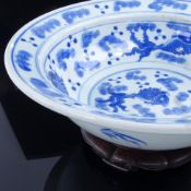 A large Chinese blue and white porcelain fish design bowl and hardwood stand, diameter 30cm. Crack