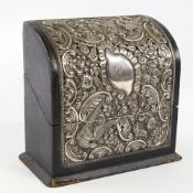 An Edwardian silver mounted stationery box, curved lid with relief embossed bird and foliate
