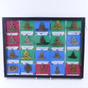 A collection of 21 Royal Artillery cap badges. In good used condition, badges are in box frame