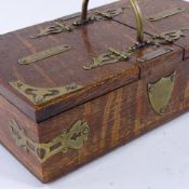 A late 19th century oak cigar and cigarette box, with dual compartments, brass mounts and match