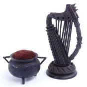 A Victorian Irish bog oak harp, and a pin cushion cauldron, harp height 14cm. Cauldron is in good