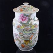 A Chinese Qianjiang cai enamelled Antiquity jar and cover, decorated with various antiques to one