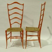 CHIAVARI, ITALY - A pair of exaggerated high ladder back chairs, in sculpted wood in the manner of