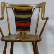 EVA & NILS KOPPEL, DENMARK, a stained beech armchair with woven woolwork back, circa 1950, height