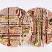 "PIERO FORNASETTI (1913-1988), ITALY, a pair of ""Orchestra"" design plates, diameter 26cm. Good"