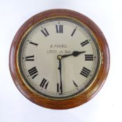 An early 20th century oak-cased circular dial wall clock, by A Powell of Leich-on-Sea, silvered dial
