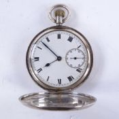An early 20th century silver full hunter pocket watch, white enamel dial with black Roman numeral